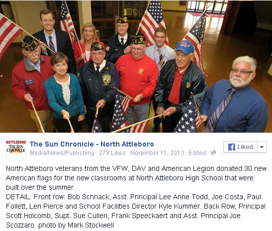 North Attleboro veterans from the VFW, DAV and American Legion donated 30 new American flags for the new classrooms at North Attleboro High School that were built over the summer. DETAIL: Front row: Bob Schnack, Asst. Principal Lee Anne Todd, Joe Costa, Paul Follett, Len Pierce and School Facilities Director Kyle Kummer. Back Row; Principal Scott Holcomb, Supt. Sue Cullen, Frank Speeckaert and Asst. Principal Joe Scozzaro. photo by Mark Stockwell